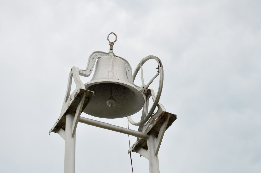 The church bell in front of the Delaware First Baptist Church.